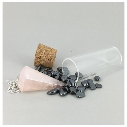 Flacon déchargeur de pendule avec pendule quartz rose